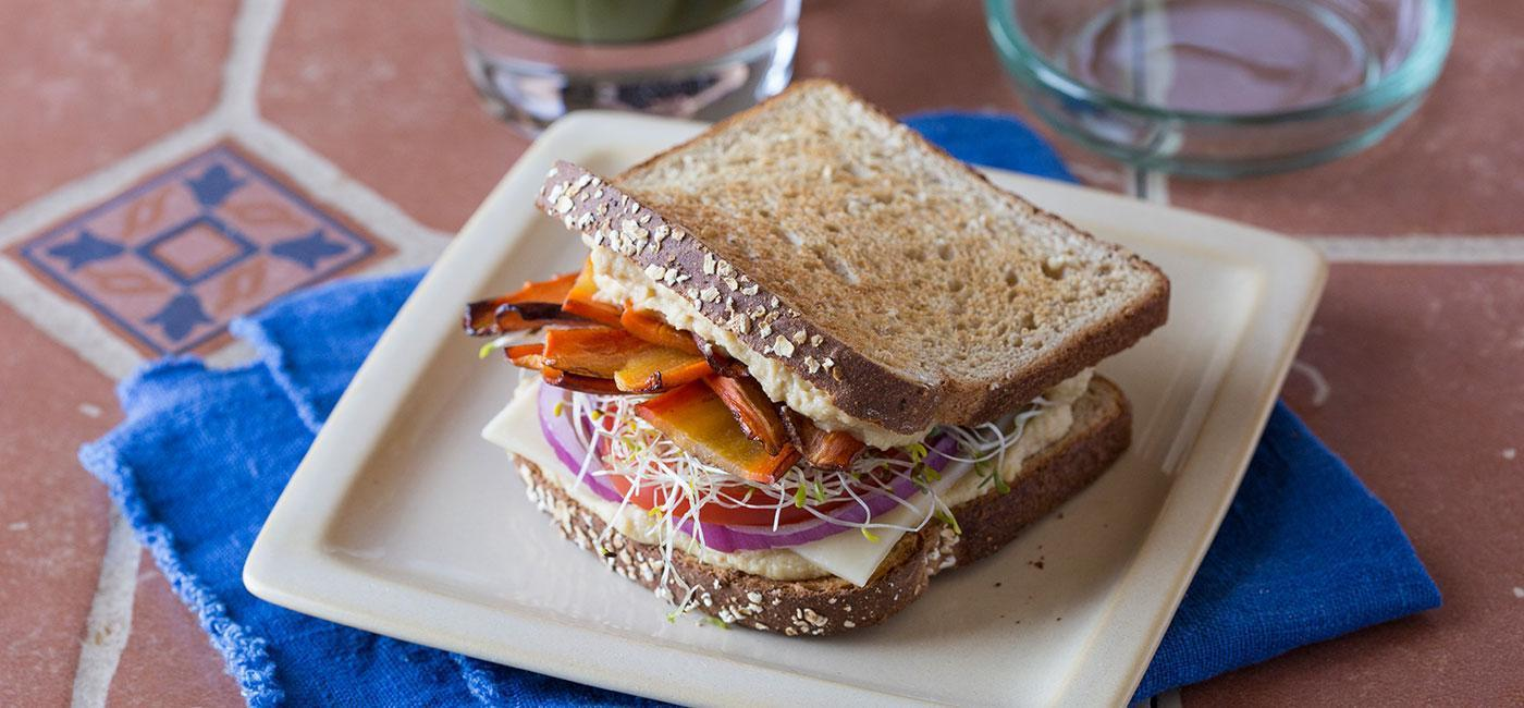 Carrot Bacon Club with Spicy Avocado, Sprouts and Hummus Recipe Image